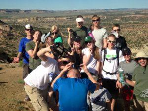 youth group event funny pose on mountaintop